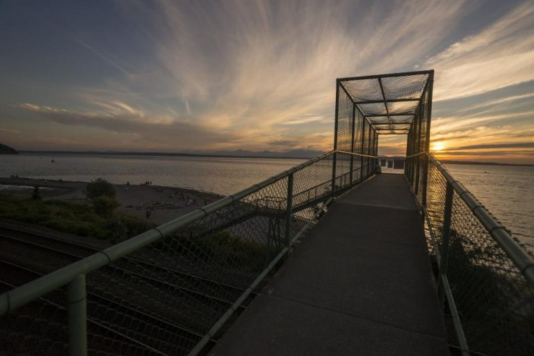 A creamsicle sky looking out from the pedestrian bridge at Carkeek Park in Seattle.