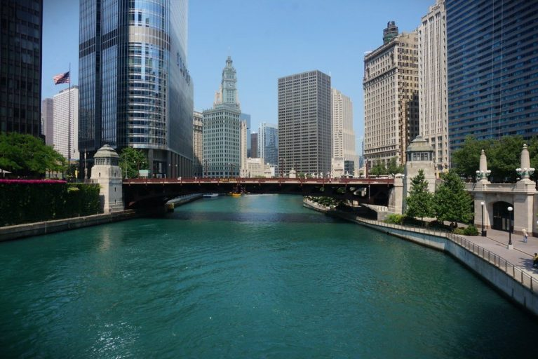 View of the Chicago River, Canal Street bridge, lined with beautiful buildings.