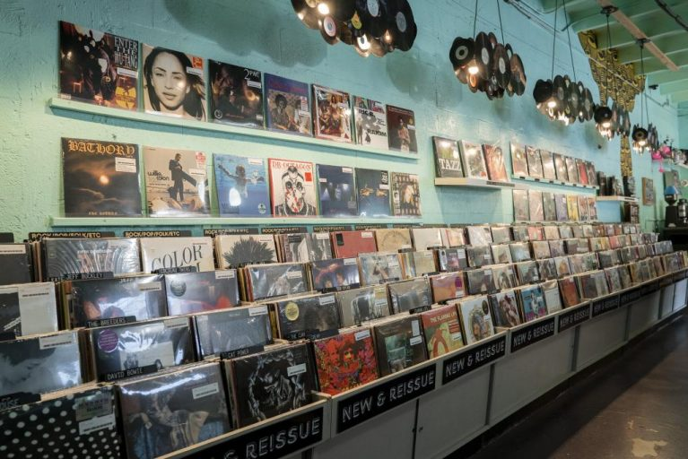 Aqua-colored walls, vinyl chandeliers and records fill the view inside Miami's Sweat Records.