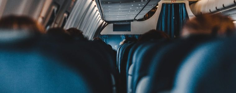 First-person view of airplane cabin as person ponders how to survive a long-haul flight.