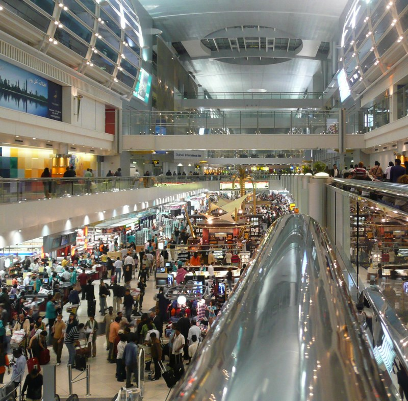 Crowded airport concourse in Dubai, United Arab Emirates (UAE), in the early morning hours.