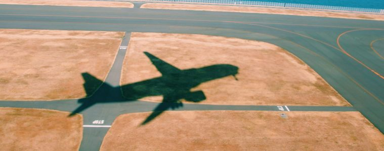 Silhouette of a plan during takeoff at Haneda Airport, Ōta, Japan