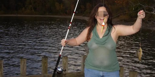 Chubby woman fishing in a see through shirt with her nipples showing.