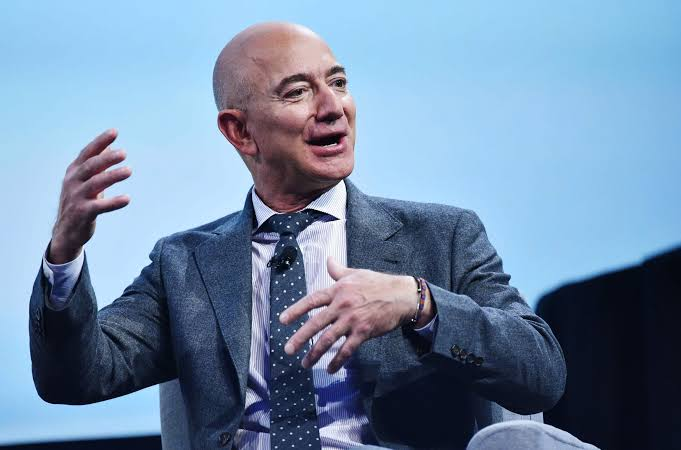 Jeff Bezos tops Forbes Billionaire List