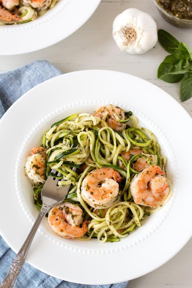 shrimp zucchini pasta in a white bowl