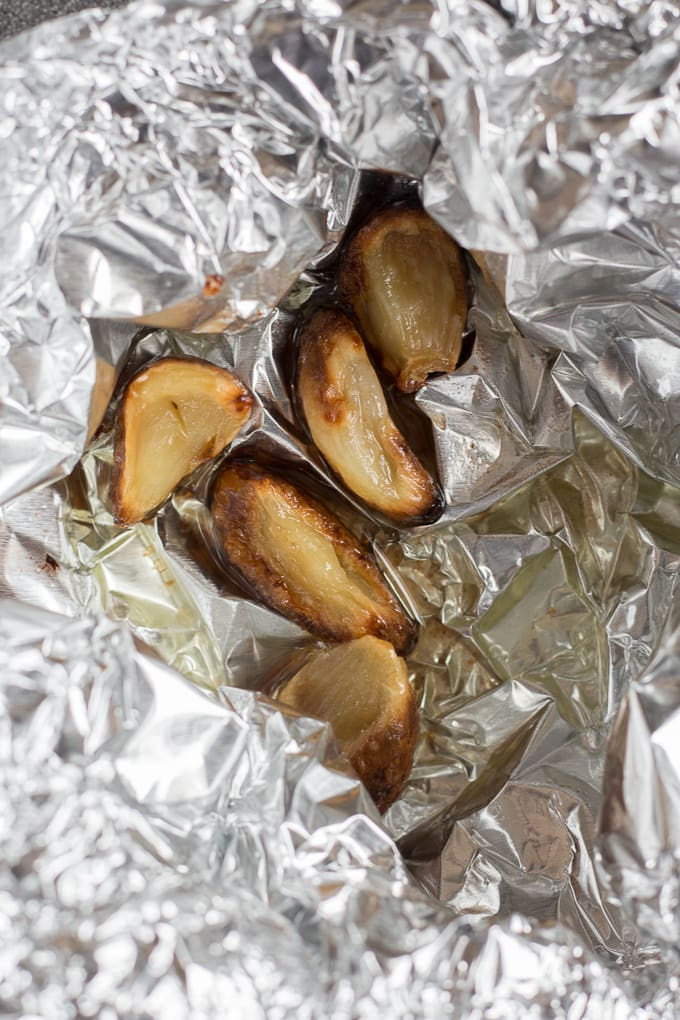 roasted garlic in oil in aluminum foil