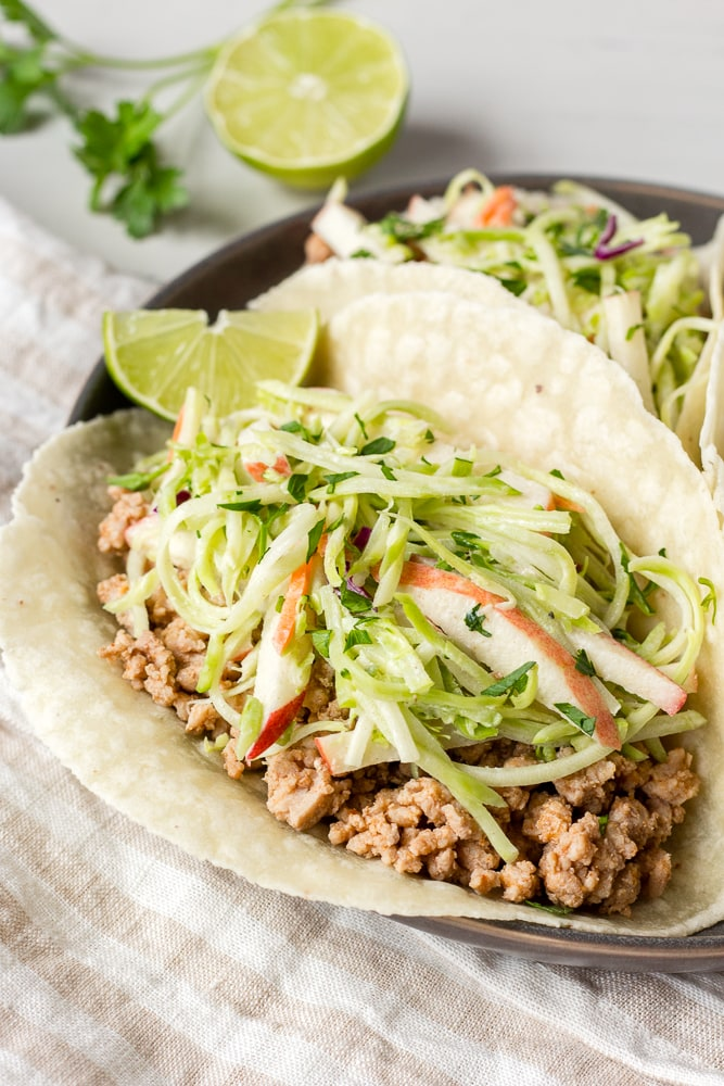 paleo ground pork tacos with lime on a plate