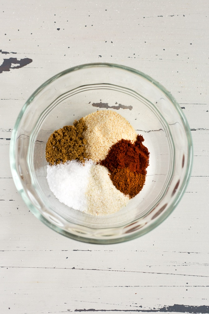 spices in a small glass bowl for pork tacos