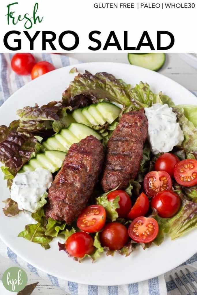 gyro salad with lamb on a white plate