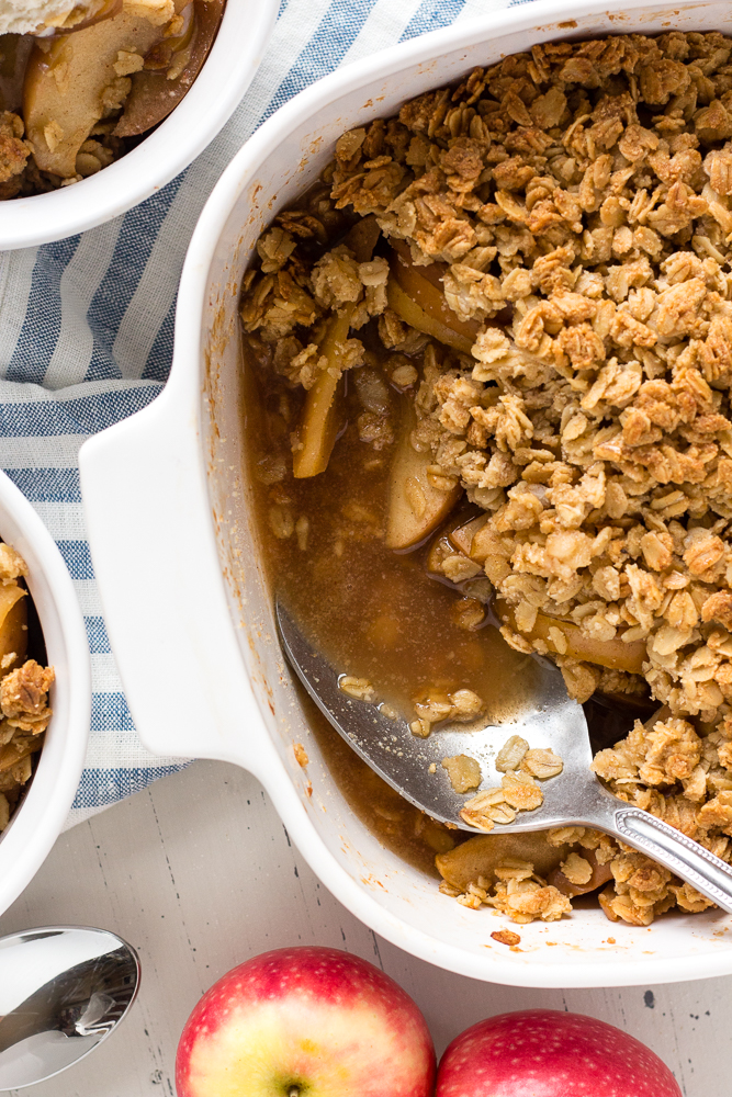 apple crisp in a dish with a spoon