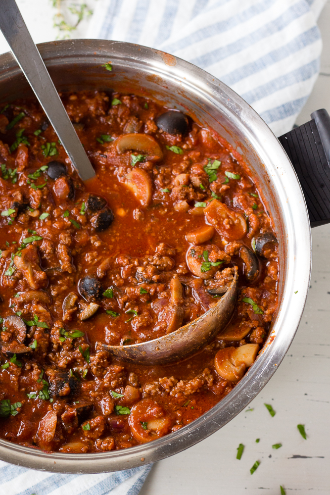 meat sauce in a pot with a ladle