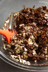 stirring chocolate into oats with a red spatula