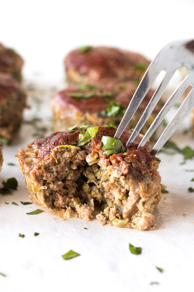 a fork taking a piece of paleo meatloaf muffins