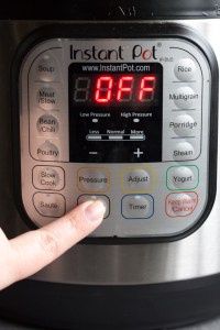 pressing manual button on instant pot