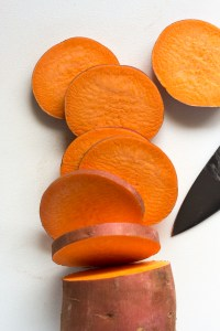 slicing a sweet potato