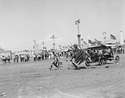 04 Sep 1922, Los Angeles, California, USA --- Original caption: Thrills Aplenty at Los Angeles Auto Polo Matches. Los Angeles, California: Thrills and spills were frequent at the auto polo match that featured that Los Angeles Pageant of Progress. One of the spills that occurred resulted in the captain of the Canadian team suffering a broken arm. Teams of picked players from Canada and the US competed. The captain of the American team being spilled in a mix-up for the ball. --- Image by © Bettmann/CORBIS