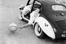 11th October 1956: A vigorous game of Motor Car Polo, the latest craze to sweep Vincennes. The players lean out of their customised Renault vehicles to scoop up the ball with lacrosse-style racquets and sweep them towards the goal. (Photo by P. F. Jentile/BIPs/Getty Images)
