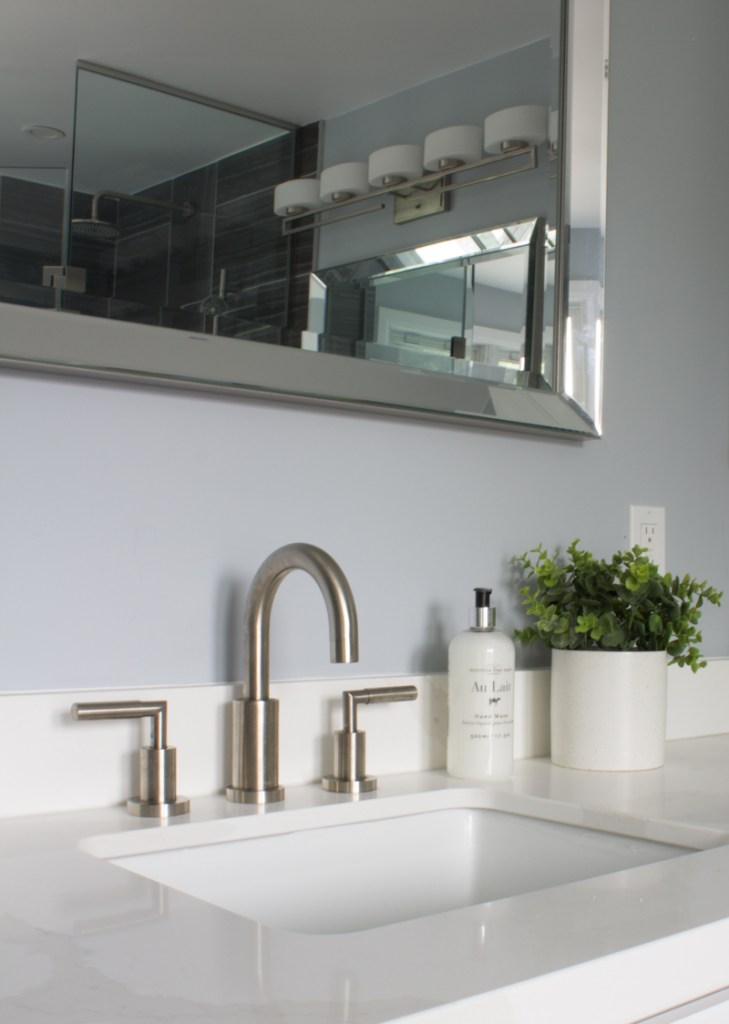 Bathroom sink and brushed nickel faucet