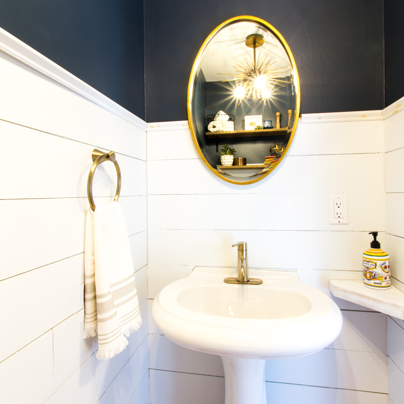 Powder room pedestal sink and oval mirror