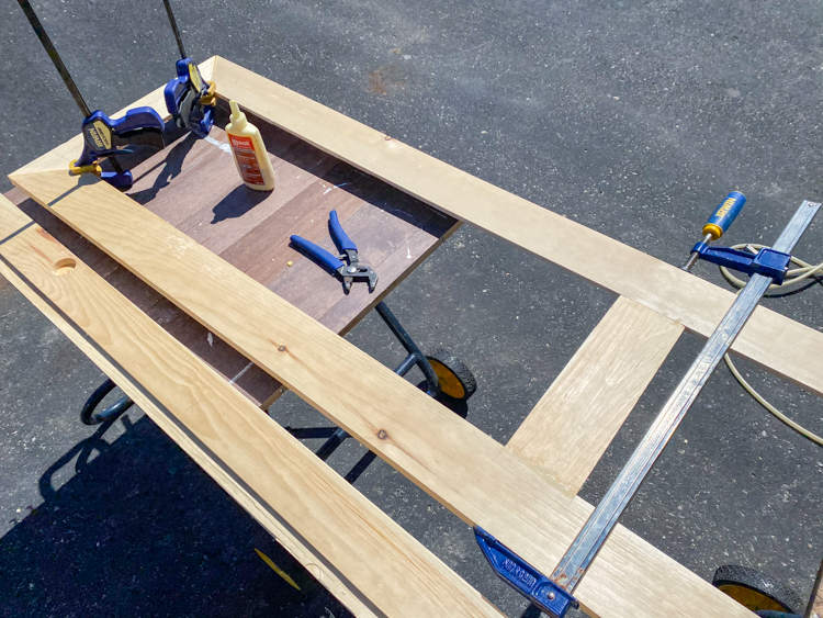 Glue frame pieces together using wood glue and clamps