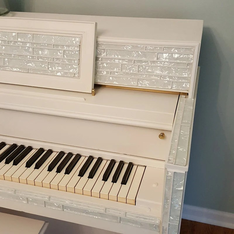 Piano with decorative mosaic tile and Fusion Paint in Casement White