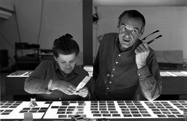 Ray and Charles Eames selecting slides for the exhibition, Photography & the City, 1968, as seen in Jason Cohn and Bill Jersey's documentary EAMES: The Architect and the Painter. © 2011 Eames Office, LLC.