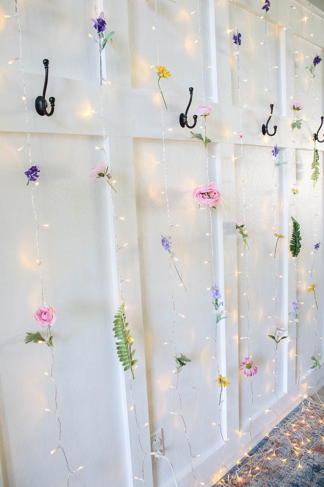 flower wall with twinkle light curtain