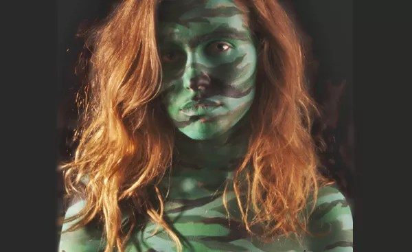 busty redhead: a sexy redhead in M81 woodland camo body paint for RED Friday
