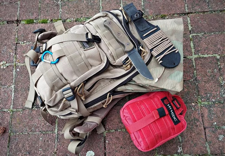 Survival bag, medical kit, knife