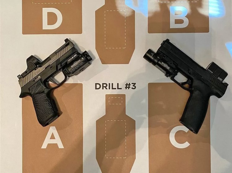 A couple different handguns types before a range session with Jeremy Stafford.