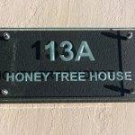 sandblasted engraved glass house number name sign mounted on slate
