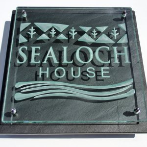 glass and slate house sign engraved and sandblasted with personalised imagery and the name sealoch house
