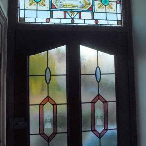 Existing stained glass transom with stick on lead door panels below