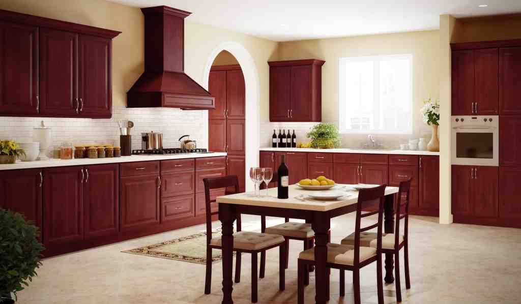Cherry colored kitchen cabinets fitted