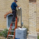 Nathan from COAD installs the vents on the second furnace.