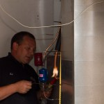 Ed puts the finishing touches on the first furnace/air conditioner