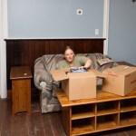 Leah unpacks some living room goodies.