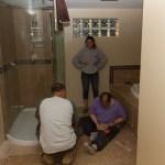 Leah, Shelley and Dan cutting tiles.