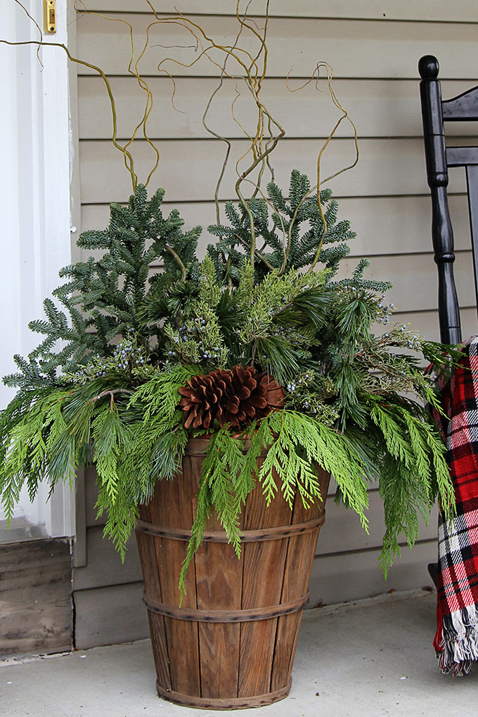 How To:  Make a Winter Porch Decorative Pot | House of Hawthornes - Quick and easy tutorial for making these GORGEOUS winter porch pots. Made in baskets for a farmhouse style, but can be made in urns for a more formal look! #christmas #christmasdecor #porch #PorchDecor #containergardening