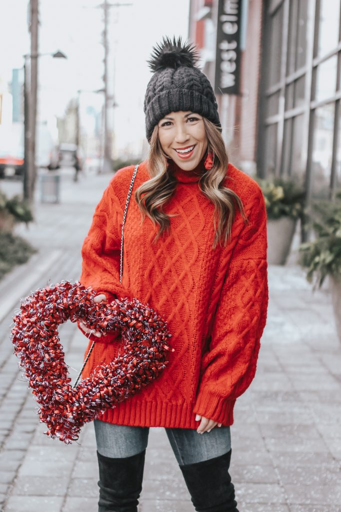 Valentine's Day Sweater featured by top US fashion blog House of Leo Blog; Image of a woman wearing a red sweater from Goodnight Macaroon.