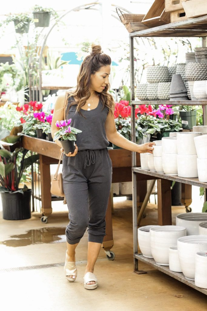 How To Wear A Jumpsuit This Spring by top US fashion blog, House of Leo Blog: image of woman wearing a Sundry jumpsuit from Evereve