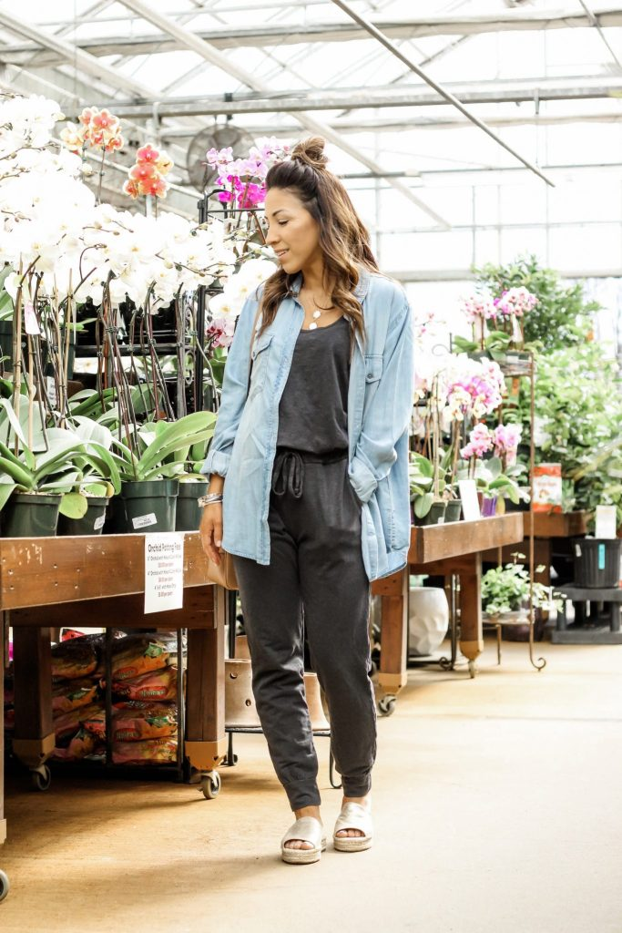How To Wear A Jumpsuit This Spring by top US fashion blog, House of Leo Blog: image of woman wearing a Sundry jumpsuit and Sanctuary boyfriend chambray shirt from Evereve