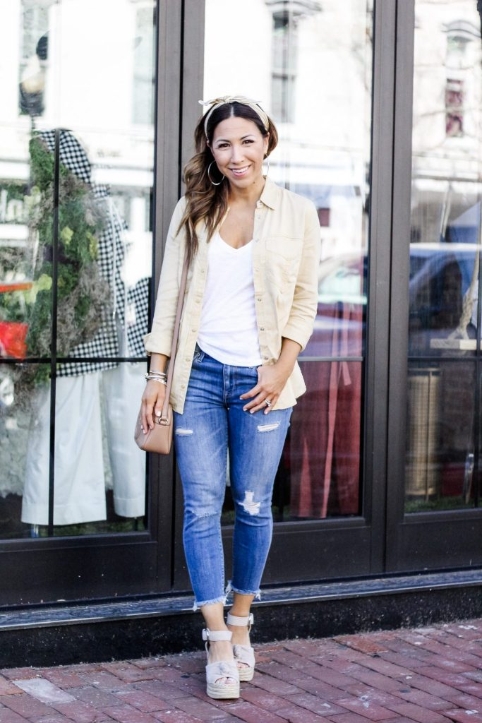 Spring Finds at Express by top US fashion blog, House of Leo Blog: image of woman wearing yellow button down, distressed cropped jeans from Express and Marc Fisher Anty espadrilles