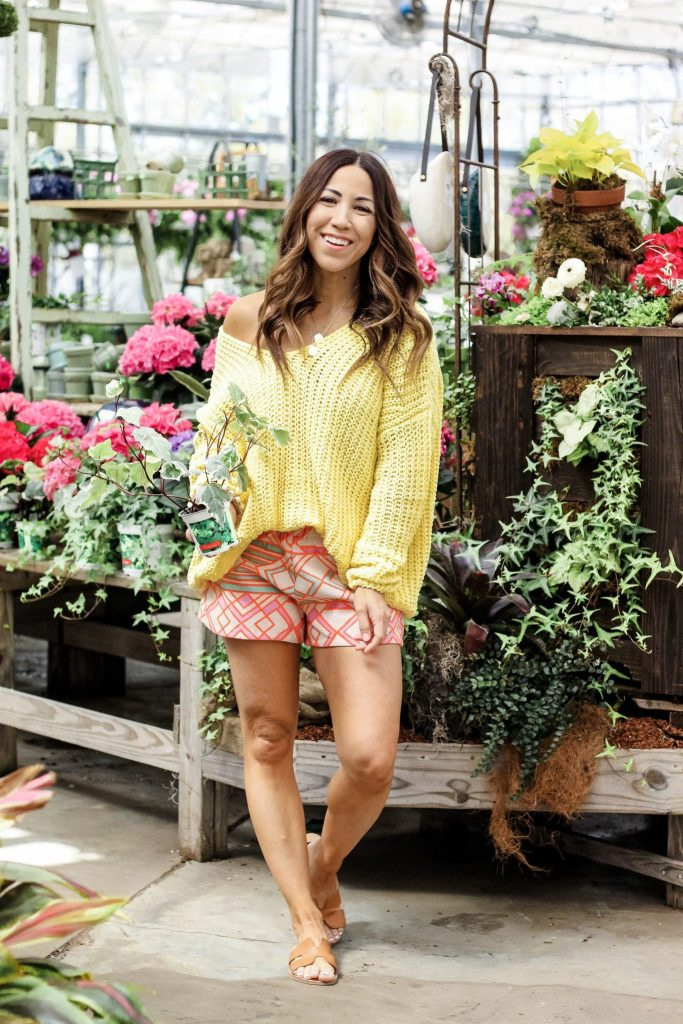 Cute Spring Outfits from Red Dress Boutique by top US fashion blog, House of Leo Blog: image of woman wearing a yellow chenille sweater, Judith March aztec shorts