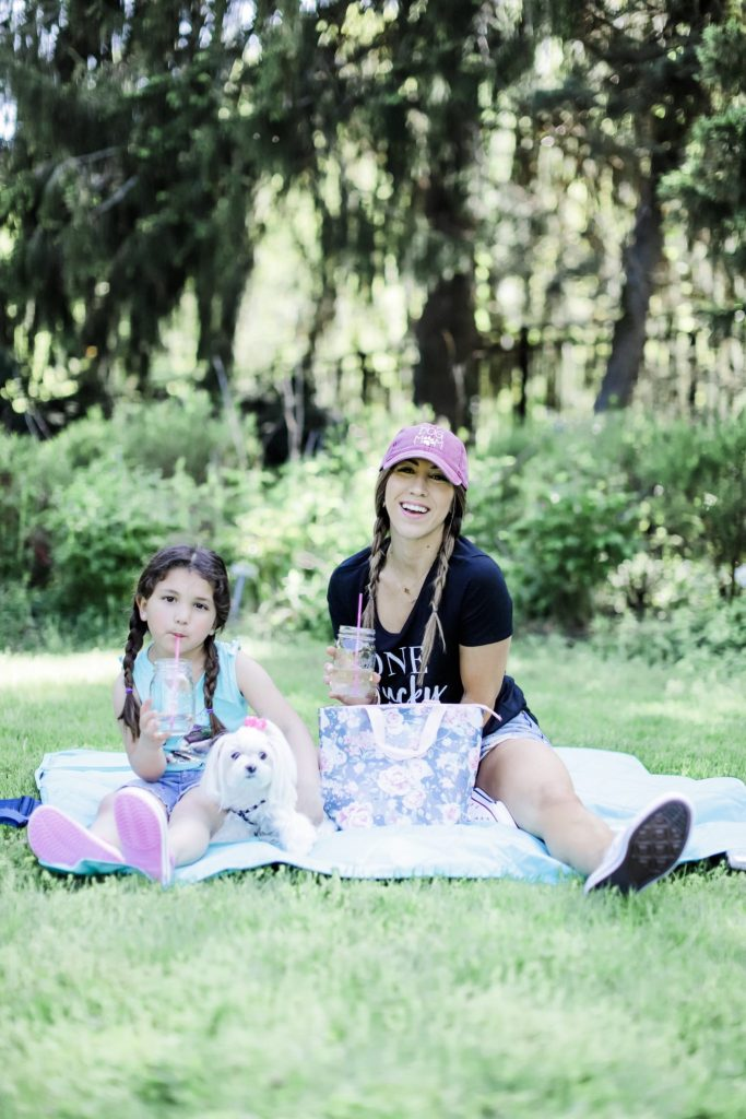 How I Balance Blogging and Being A Mom With Stage Stores by top US fashion blog, House of Leo Blog: image of mother and daughter having a picnic