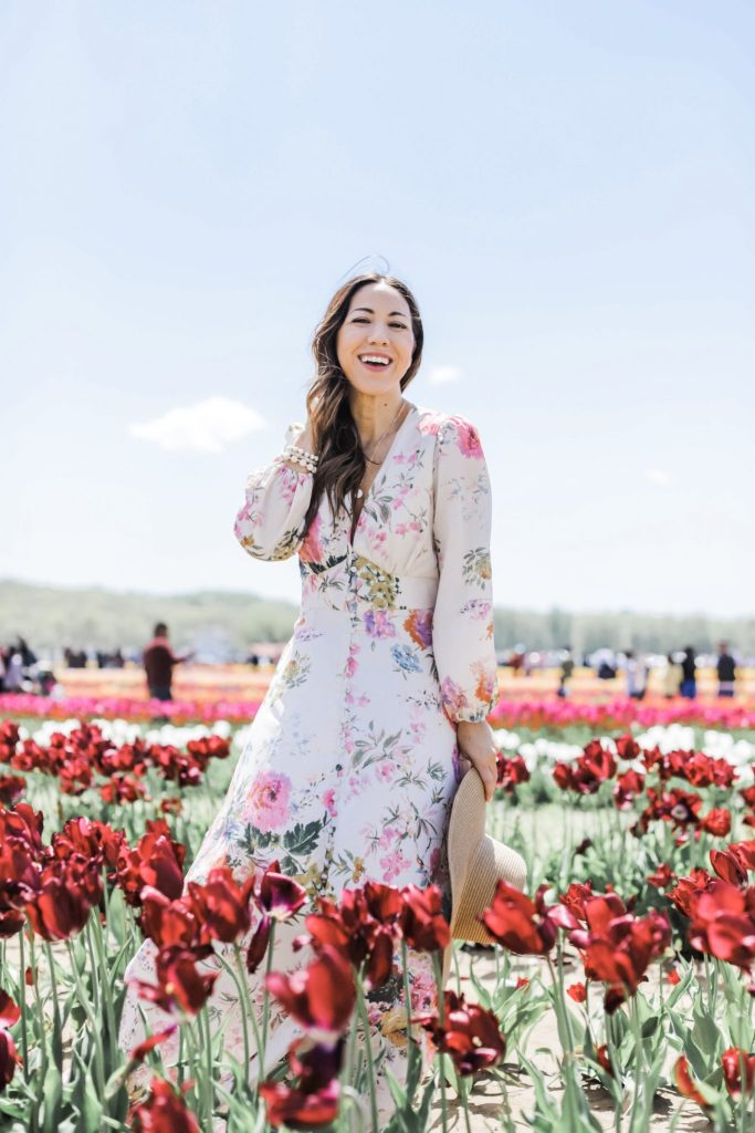 2 Year Blogiversary: 5 Top Tips on How to Grow Your Blog in a Couple of Years by top US fashion blog, House of Leo Blog: image of woman at Holland Ridge Tulip Farm wearing a Chicwish floral dress