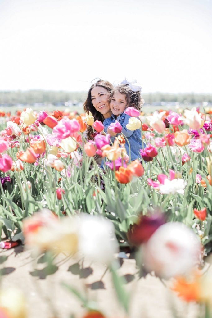 2 Year Blogiversary: 5 Top Tips on How to Grow Your Blog in a Couple of Years by top US fashion blog, House of Leo Blog: image of woman and child at Holland Ridge Tulip Farm