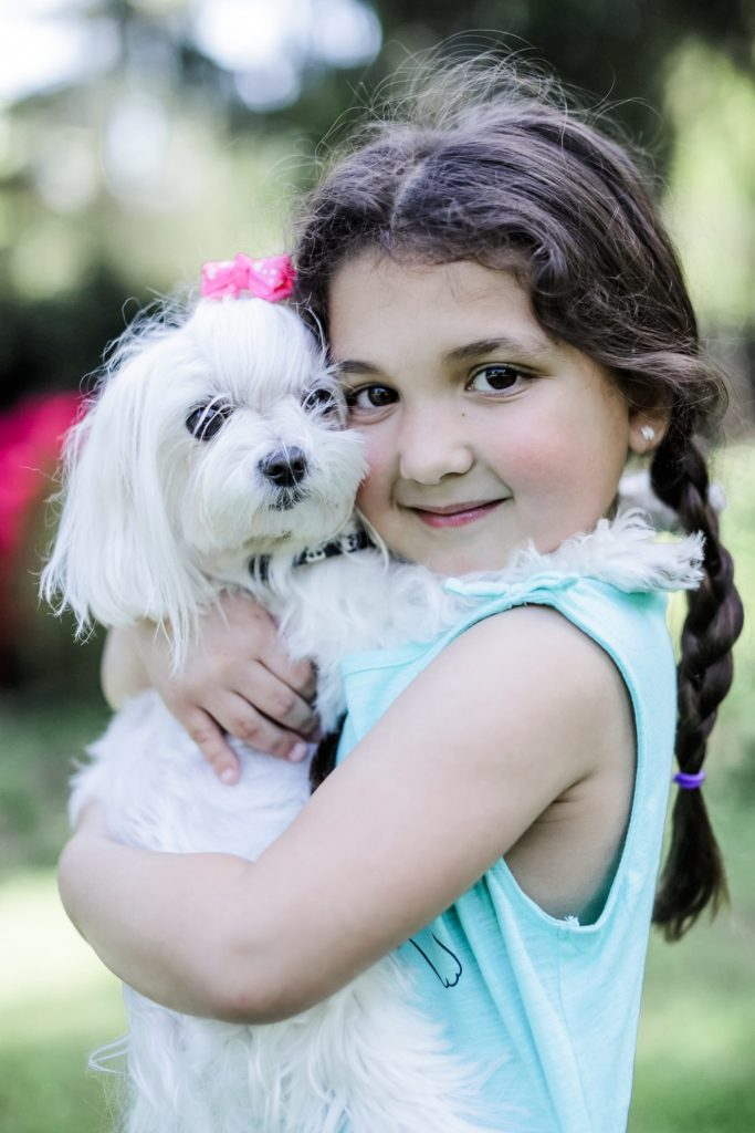 How I Balance Blogging and Being A Mom With Stage Stores by top US fashion blog, House of Leo Blog: image of little girl with maltese