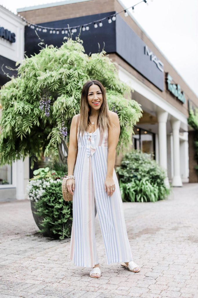 Easy Spring and Summer Outfits From Red Dress Boutique by top US fashion blog, House of Leo Blog: image of woman wearing stripe jumpsuit
