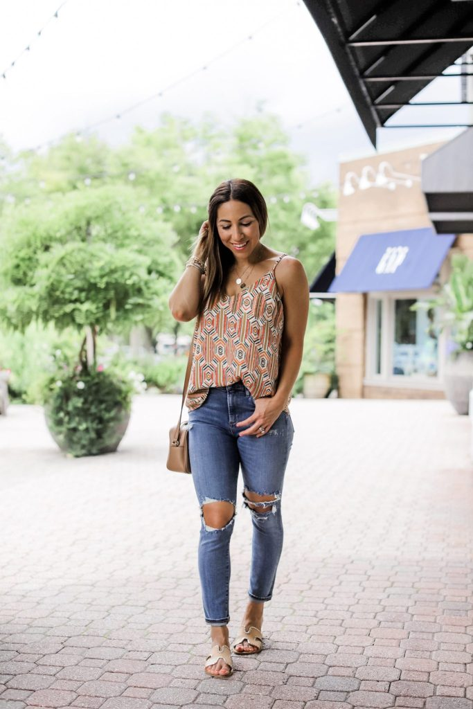 Evereve 4th of July Sale by top US fashion blog, House of Leo Blog: image of woman wearing aztec cami, agolde sophie jeans and steven greece slides